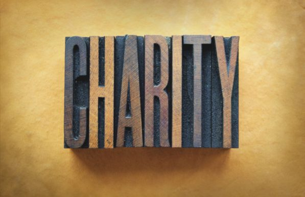 The word CHARITY written in vintage letterpress type.